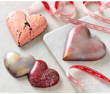 Chocolate Candy Heart filled with Vanilla Marshmallow Passion Fruit Caramel and Chocolate Crunchy Almonds